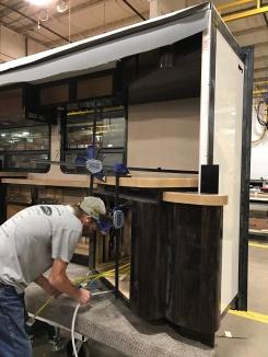 Employee installing cabinets